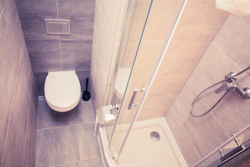 A bathroom at Apartamenty 21 Basic