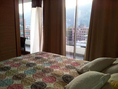 Cama o camas de una habitación en Aucity Suites