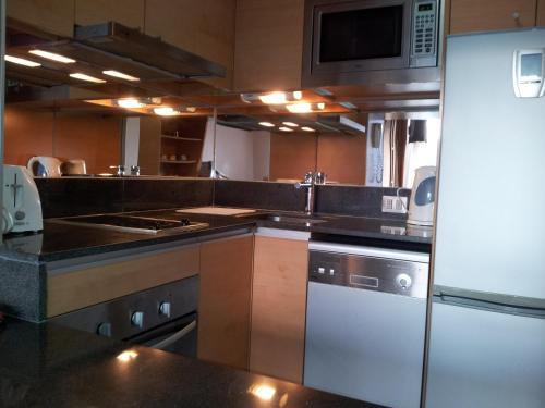 Una cocina o zona de cocina en Aucity Suites