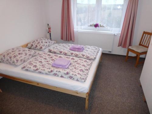 A bed or beds in a room at Ubytování Farma U sv. Jakuba