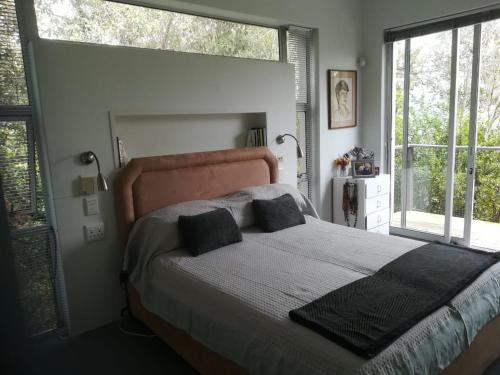 A bed or beds in a room at Treehaven