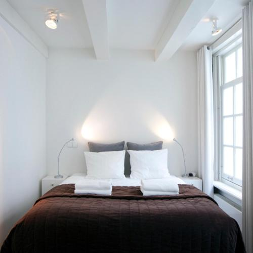 מיטה או מיטות בחדר ב-Charles Apartments