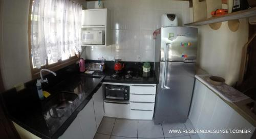 A kitchen or kitchenette at Residencial Sunset