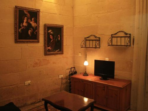 A television and/or entertainment center at Domus Luxuria - Qormi