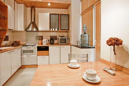 A kitchen or kitchenette at StudioMinsk 5 Apartments