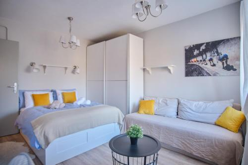 A bed or beds in a room at BOOKit apartment