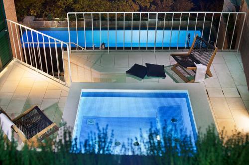 The swimming pool at or near Villa Paulina