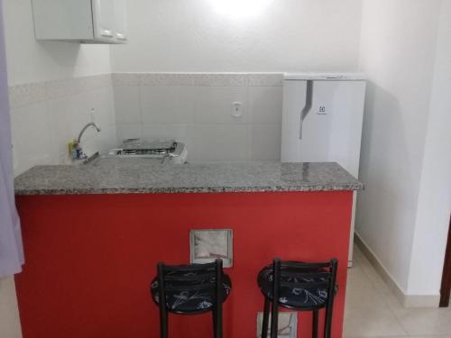 A kitchen or kitchenette at Chalé Da Fran