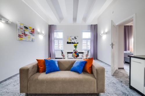 A seating area at SAVOY Mariacka Apartments