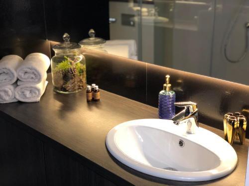 A bathroom at D&M Apart Suraska 4