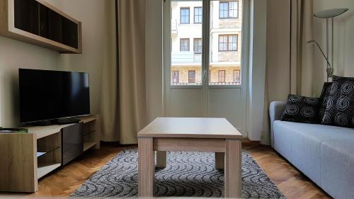 TV a/nebo společenská místnost v ubytování Villa Wingolf