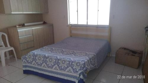 A bed or beds in a room at Casa na Raposa