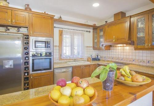 A kitchen or kitchenette at Teulada Villa Sleeps 8 Pool