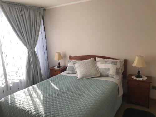 Cama o camas de una habitación en Andes Apart Homes: Carmenere