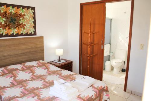 Cama o camas de una habitación en Casa H. Neves - Praia da Lagoinha