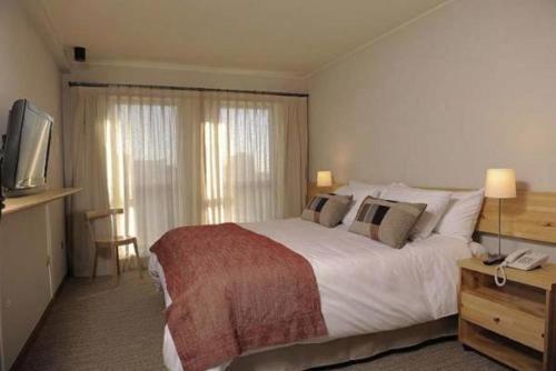 Cama o camas de una habitación en Aurelio Hotel & Apart