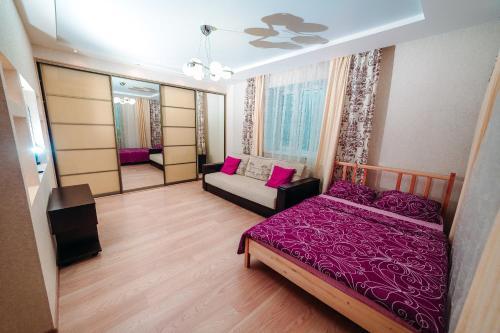 Кровать или кровати в номере Apartment on the Sadovaya