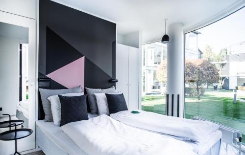 Een bed of bedden in een kamer bij Kolding Hotel Apartments