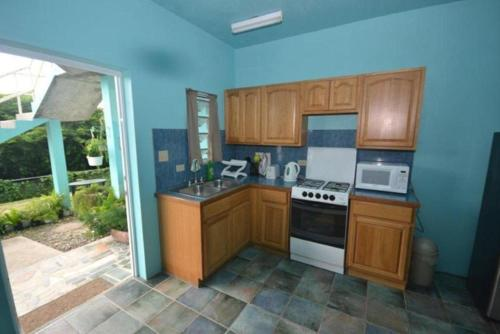 A kitchen or kitchenette at Lamblion Holiday Apartment