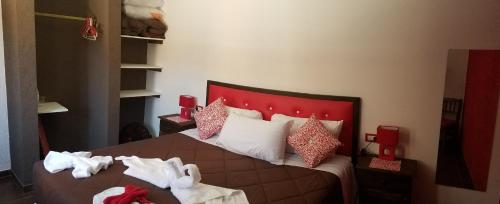 A bed or beds in a room at Complejo Los Cipreses