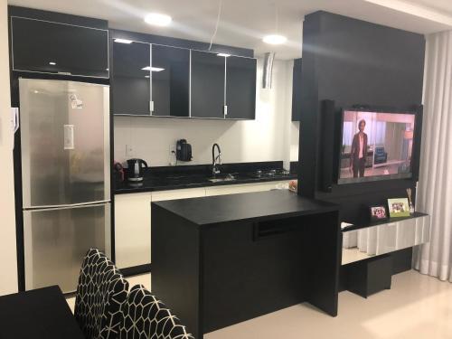 Una cocina o zona de cocina en Apartamento Super Aconchegante