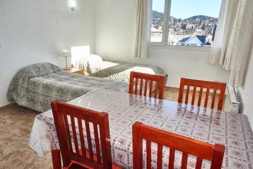 Un lugar para sentarse en Apartamentos Rolando