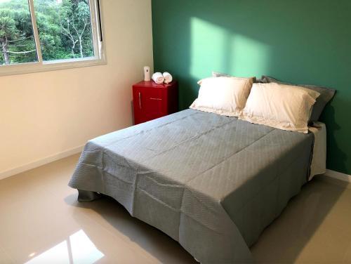 Cama o camas de una habitación en Apt Novo, Impecável, 1500m da Praia do Campeche