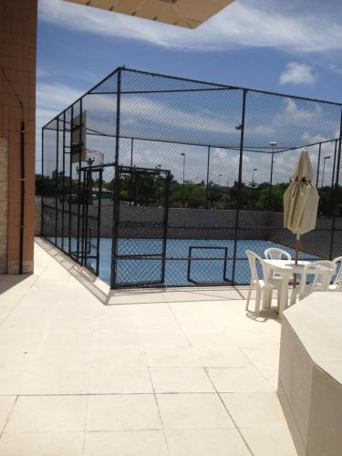 The swimming pool at or near Apartamento, 2quartos,perto da praia e do shooping