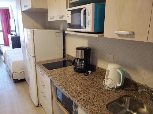 Una cocina o kitchenette en Apart 440
