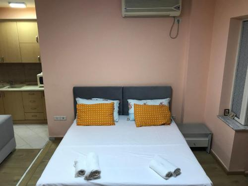 A bed or beds in a room at Apartment in Tirana