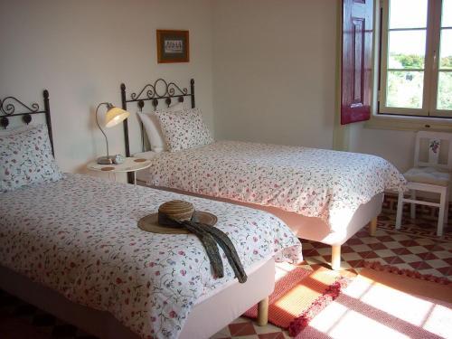 A bed or beds in a room at Quinta da Vila Maria