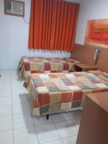 A bed or beds in a room at Flat em Thermas Paradise