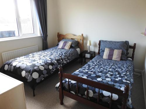 A bed or beds in a room at Belair in Whitehead