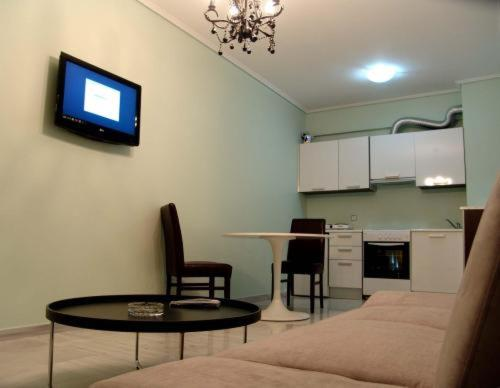 A television and/or entertainment center at Art Suites Athens