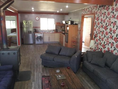 Zona de estar de Espectacular Casa Pucon 10 personas
