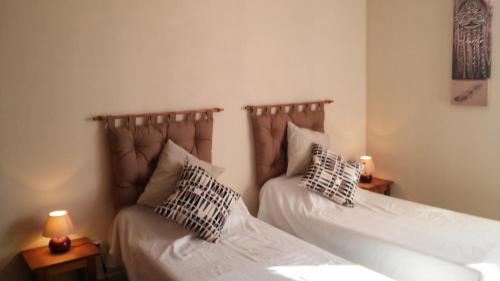 Domaine du Barvy tesisinde bir odada yatak veya yataklar