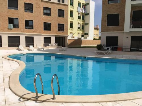 The swimming pool at or near Meg N John's getaway place | 2 bedroom apartment w/ pool near the beach