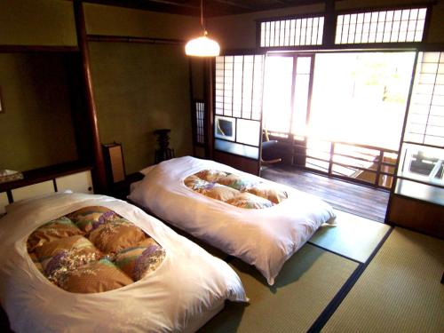 A bed or beds in a room at Itsumoya