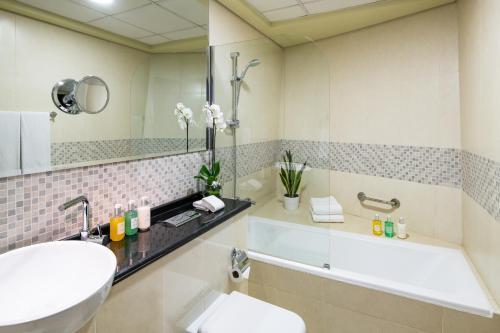 A bathroom at Citadines Metro Central Apartments