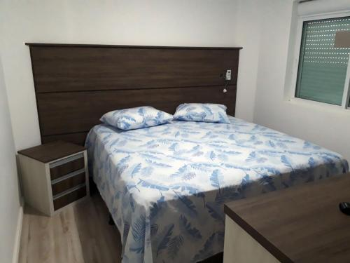 A bed or beds in a room at Real Plaza Flat 1505