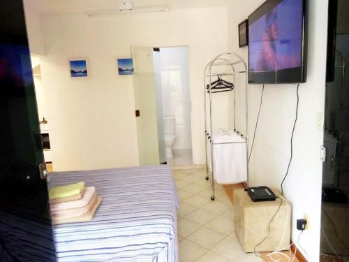 Cama o camas de una habitación en Apartamento Com Vista Para a Mata