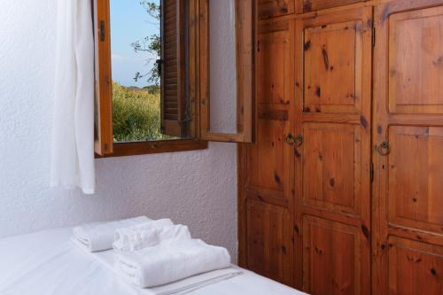 A bed or beds in a room at Elounda Island Villas