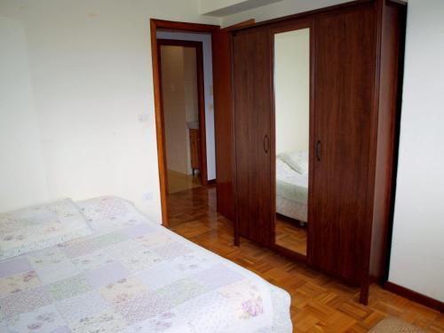 A bed or beds in a room at Piso con vistas, cómodo y con buena ubicación