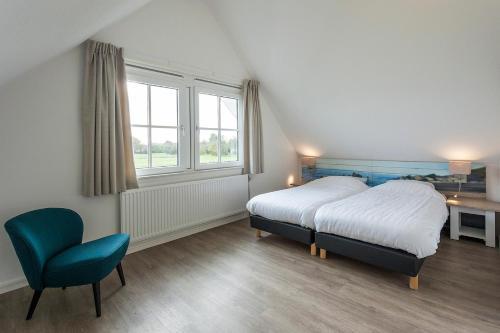 Postelja oz. postelje v sobi nastanitve Buitenplaats Witte Raaf aan Zee