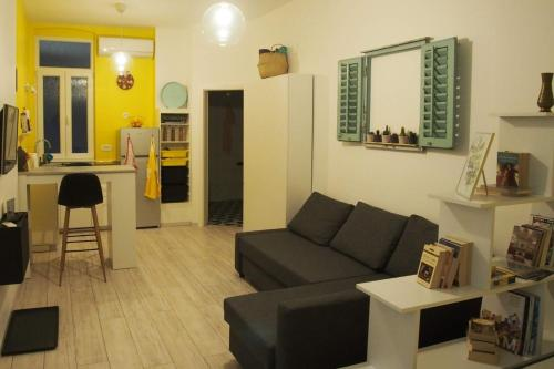 A seating area at Studio Apartman Baronessa Adriana