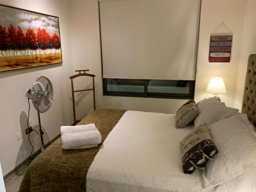 Cama o camas de una habitación en San Martin Downtown