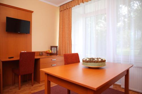 TV a/nebo společenská místnost v ubytování Hotel Napsugar