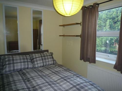 Cama ou camas em um quarto em St Andrews