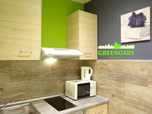 A kitchen or kitchenette at Greengary Budapest apartments