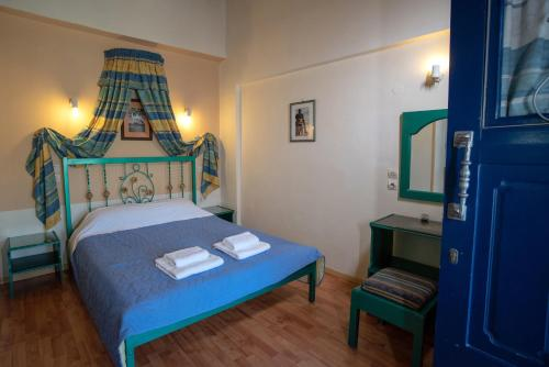 A bed or beds in a room at Kleoni Club Apartments
